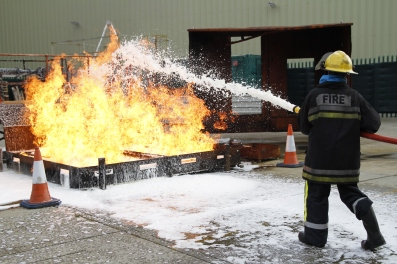 Scouts learning fire fighting skills at Ventact